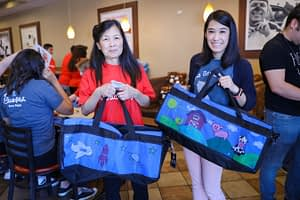 Mother and daughter decorates sweet cases